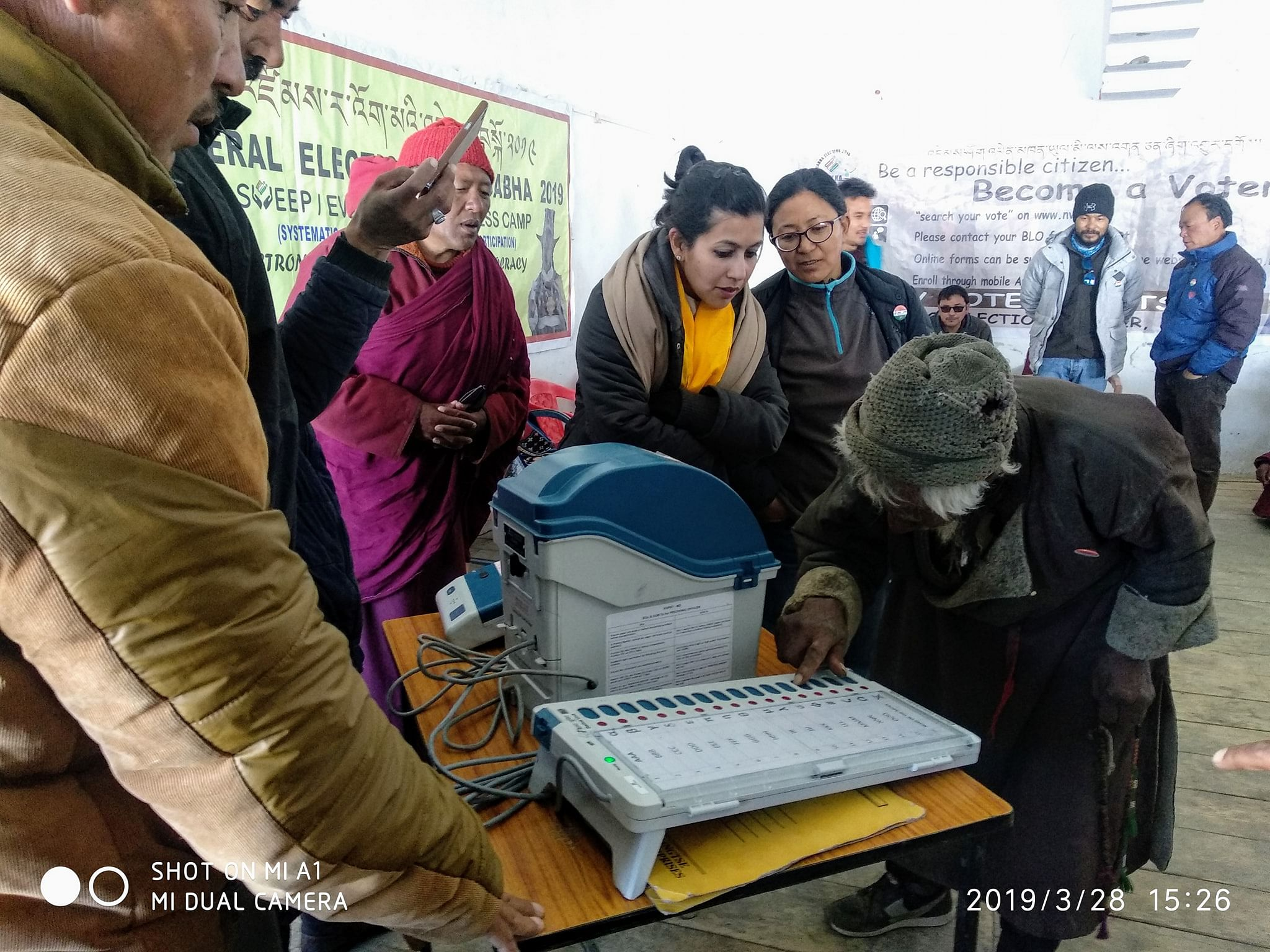 An elderly man tries his hand at an EVM machine in a remote Changthang village. (Source: Facebook)