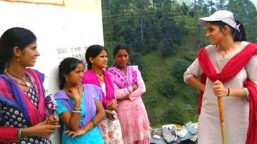 District Magistrate Sonika with residents of Pujaldi village in Tehri Garhwal village. (Source: Facebook/Bharat Bhushan Lekhwar)
