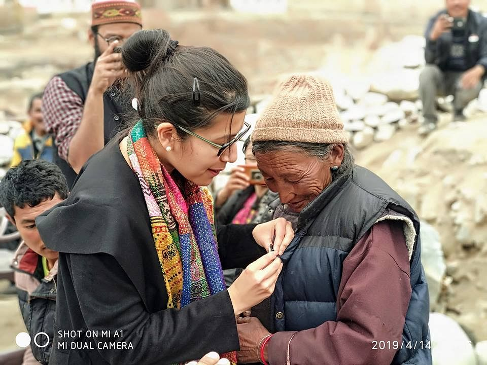 District Election Officer Avny Lavasa pinning a 'My Vote Counts' bade on a elderly woman during an awareness drive. (Source: District Administration Leh)
