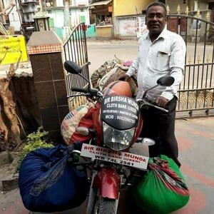 Saju Talukdar on his way to distributing clothes. (Source: Facebook/Saju Talukdar)