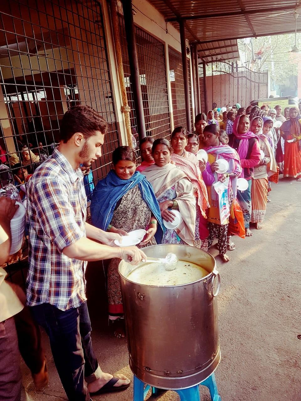 Serving breakfast outside the maternity hospital in Koti.