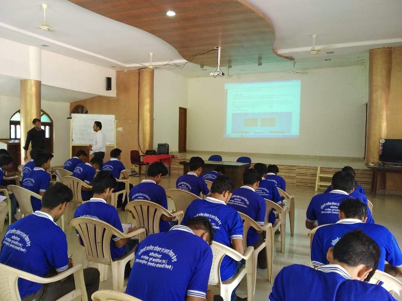 Men sitting through vocational training. (Source: SS Rawat)