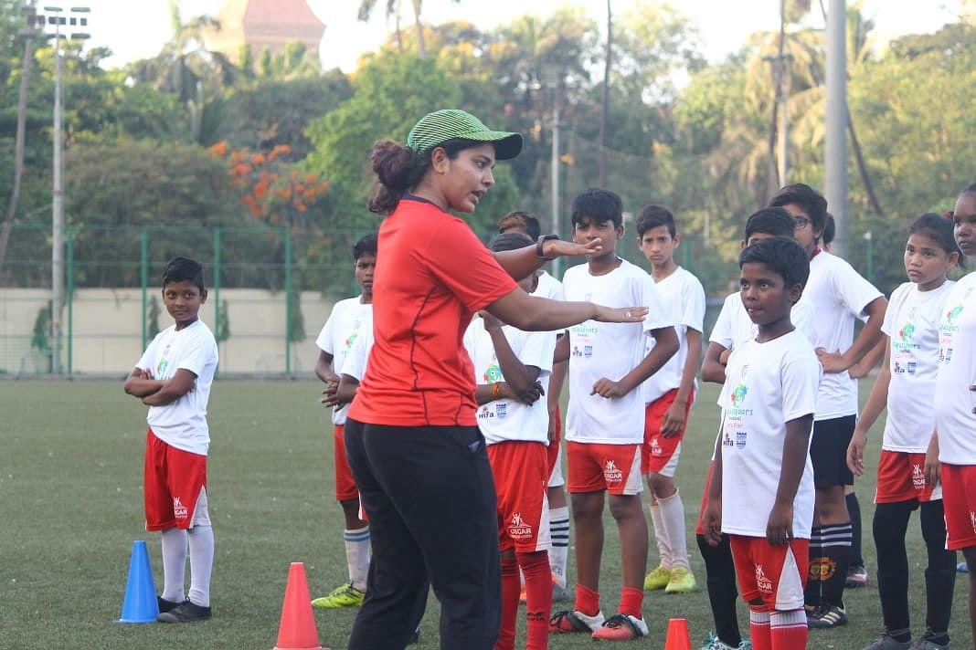 Coaching young kids in Mumbai.