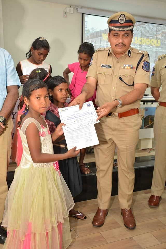 Commissioner Mahesh Bhagwat presenting certificates for students who will now re-join school in Odisha. (Source: Rachakonda PRO)
