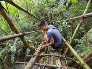Morningstar working on a living root bridge. (Source: Facebook/Living Bridge Foundation)
