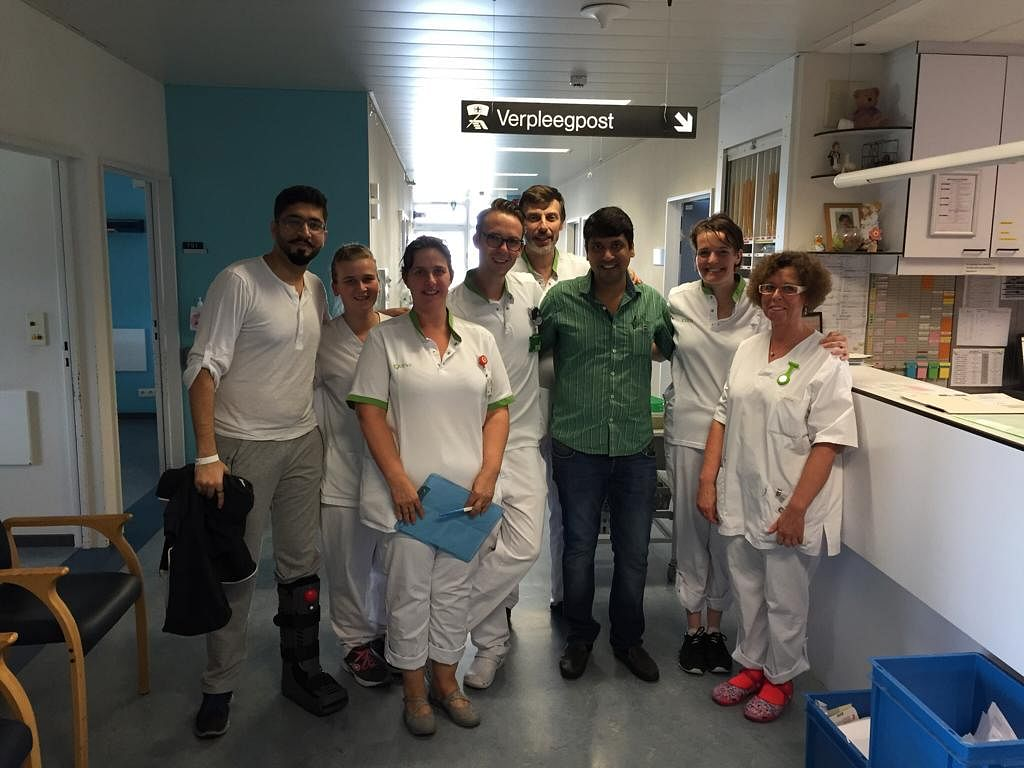 Amit, Sachin and the medical staff at the hospital in Antwerp that did a remarkable job fixing his body and saving his eyesight. (Source: Amit Motwani)