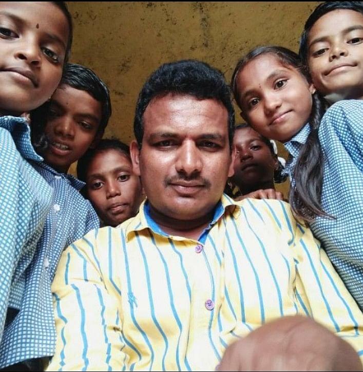 Headmaster G Satish with his students. (Source: G Satish)