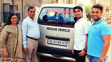 Vivhan standing in front of the rescue vehicle/ambulance he's bought with the money raised. (Source: Vivhan)