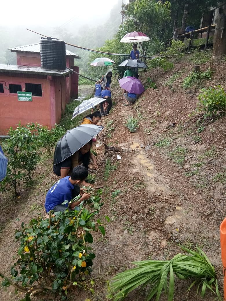 Come rain, come shine, these students are preparing for a healthy future. (Source: Students preparing the ground for nutrition garden. (Source: DC Lawngtlai)