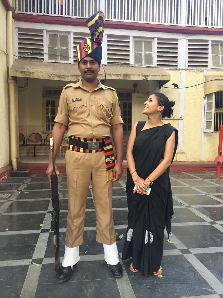 Sunchika Pandey (Right) standing next to a tall Mumbai cop. (Source: Sunchika Pandey)