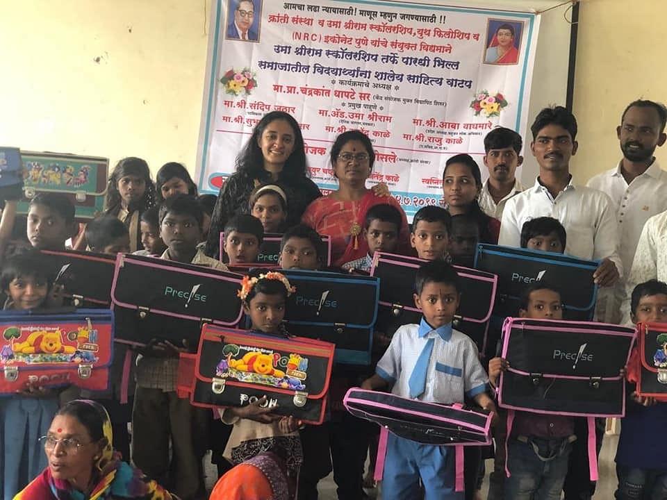 Sunita standing next to Uma Sriram (Left), alongside young children who will benefit from their work.