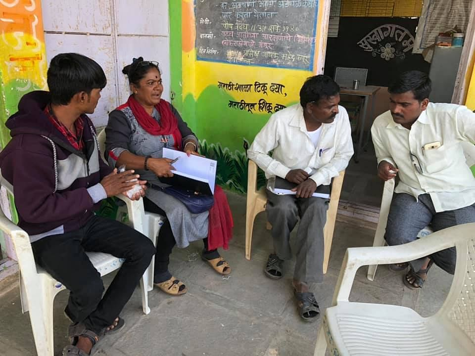 Sunita discussing matters with some of her volunteers.