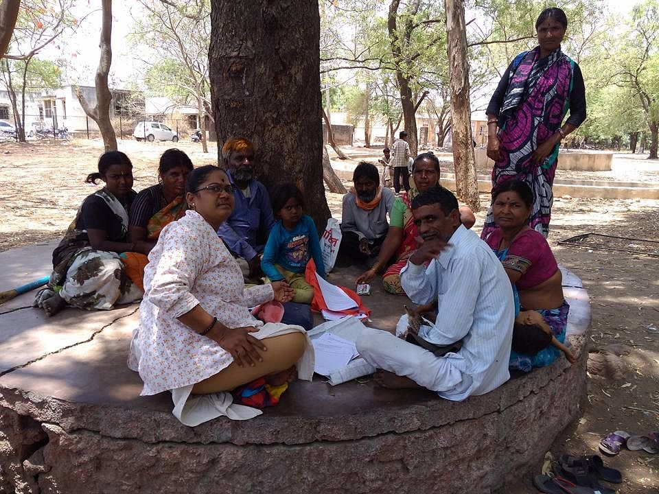 Spreading the word: Sunita during a gathering with some village folk.