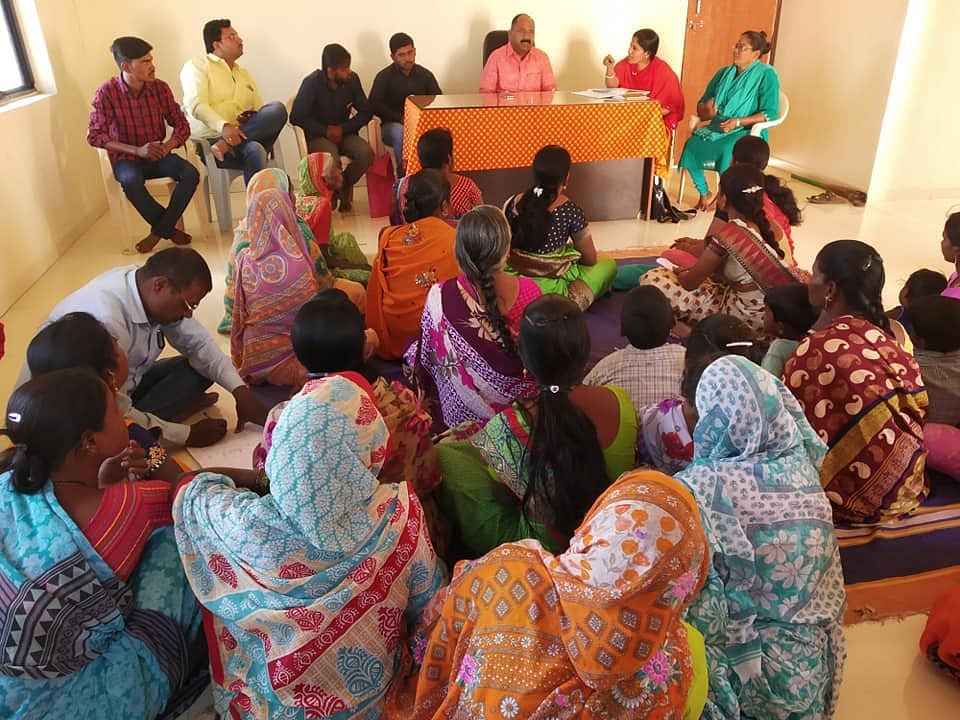 Sunita addressing local government officials alongside other women from the Pardhi community.