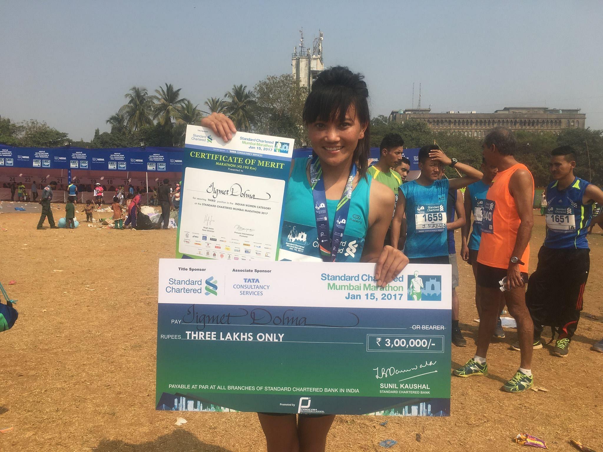 Jigmet Dolma with her prize money following the Mumbai Marathon. (Source: Ladakh Marathon)