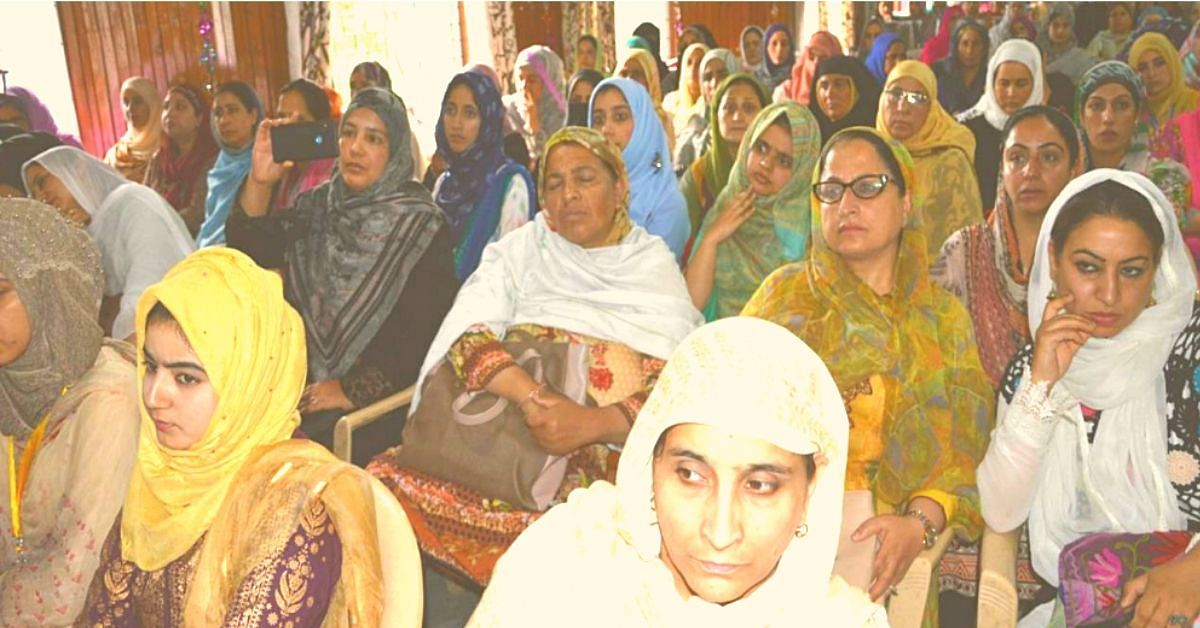 Women of all age groups attending a menstrual health awareness session.