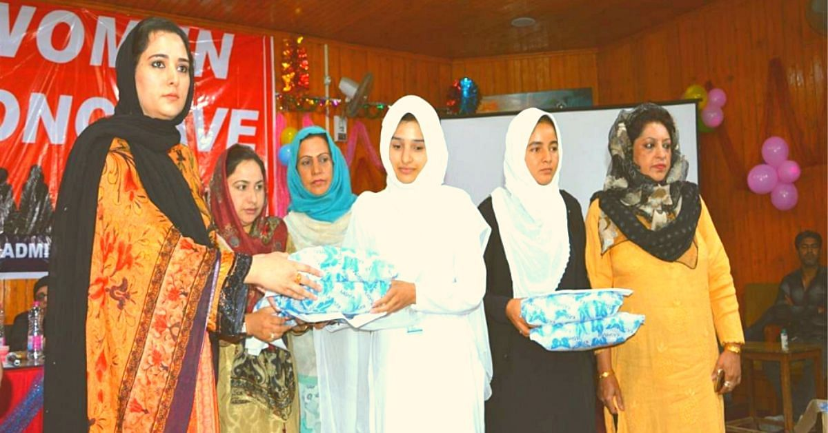 DC Syed Sehrish Asgar giving away sanitary pads to young school girls during an awareness drive..