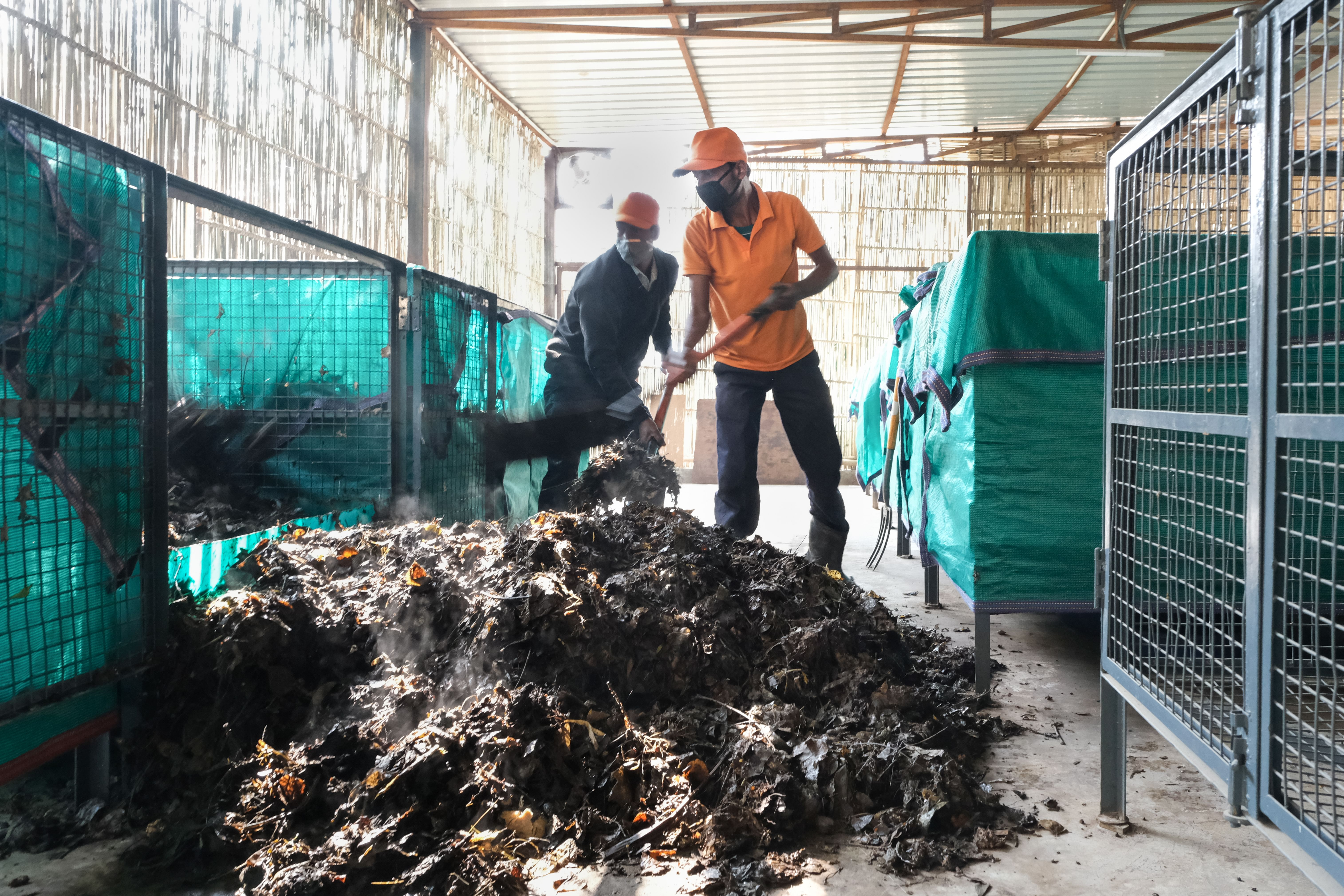 """Churning compost at the """"on-site"""" composting centre. (Source: Saahas)"""