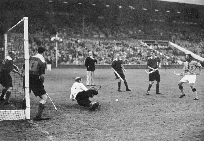 India scoring their third goal in the final. (Source: Wikimedia Commons)