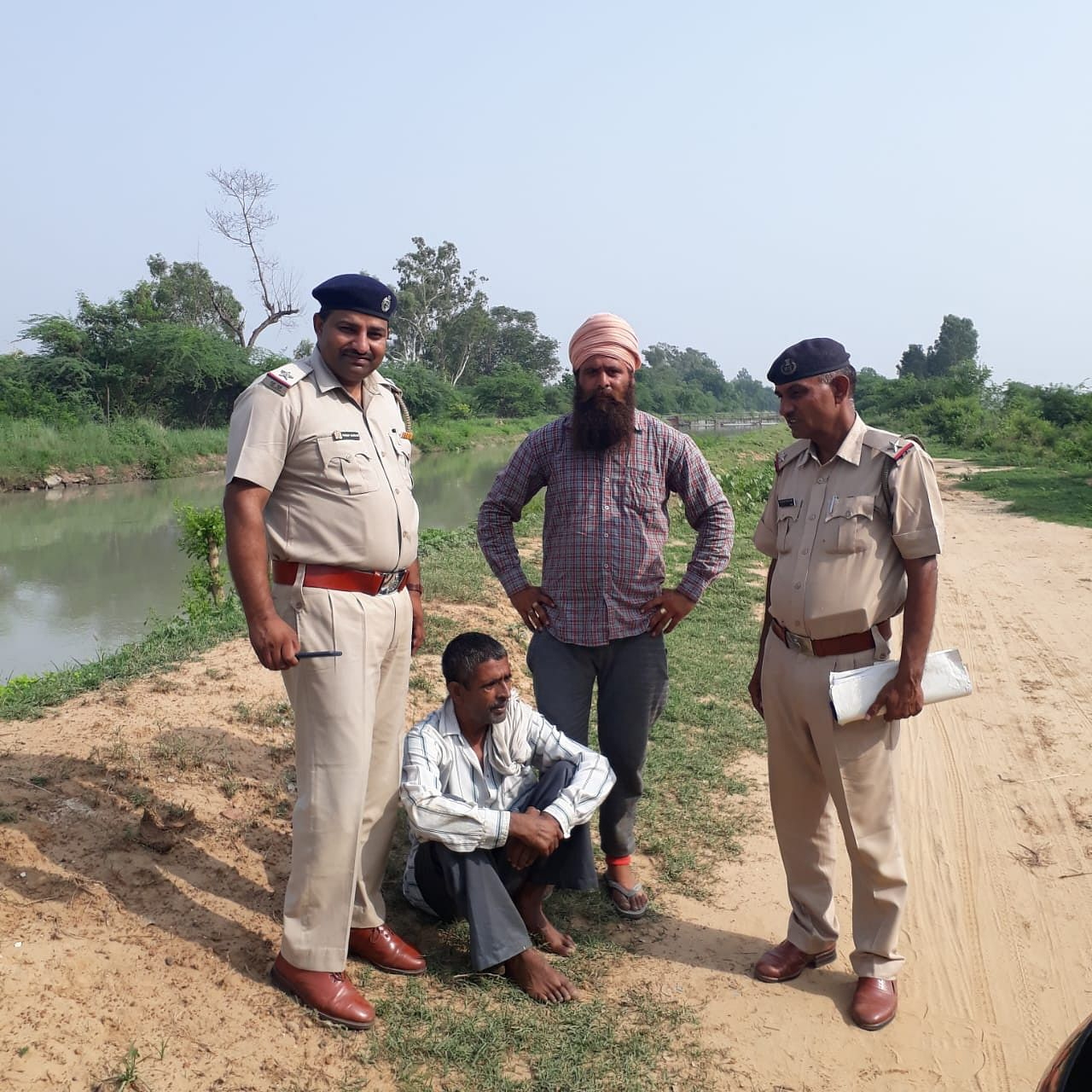 Pargat Singh (In a turban) with a man he saved, alongside local police personnel. (Source: Pargat Singh)