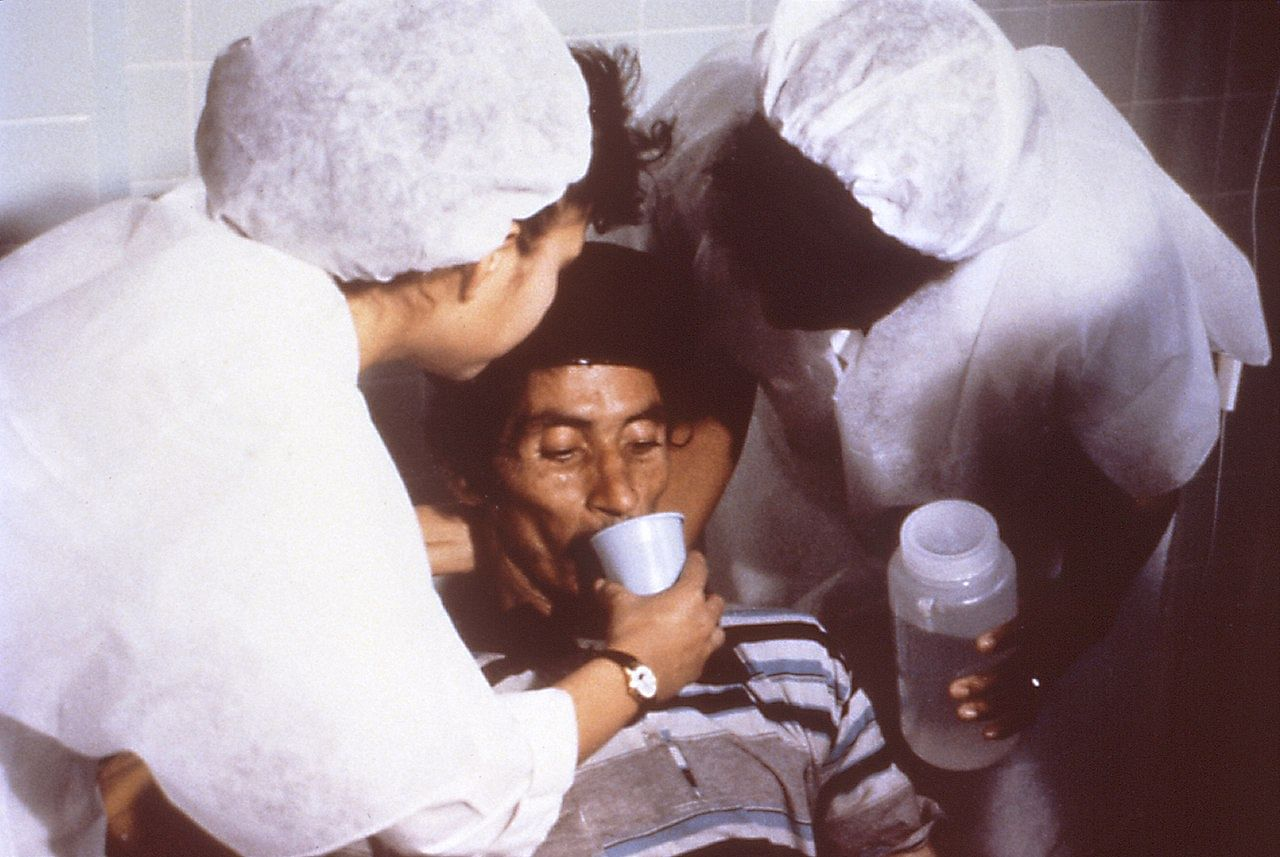 Cholera patient drinking ORS. (Source: Wikimedia Commons)