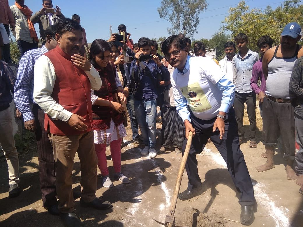 District Magistrate Heera Lal leading the way in showing locals how to construct contour trenches.