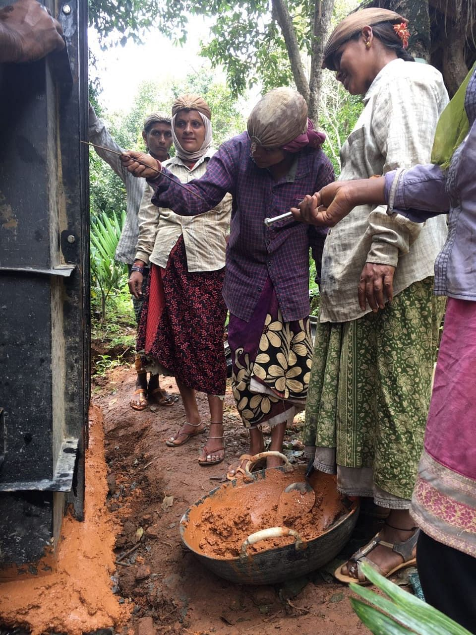 Training women to construct toilets. (Source: AMMACHI Labs)