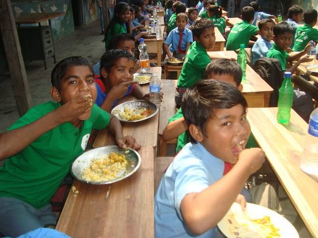 Young students enjoying the mid-day meal. (Source: Facebook/CECS)
