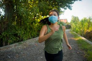 girl exercising wearing mask