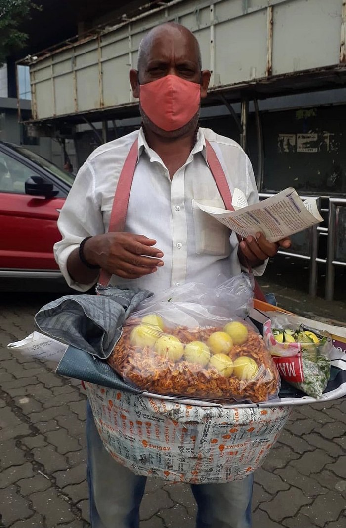 A Man selling Chana jor Garam in Mumbai near Mithibai College